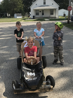 Mrs. Poggendorf's Class racing Muscle Carts.