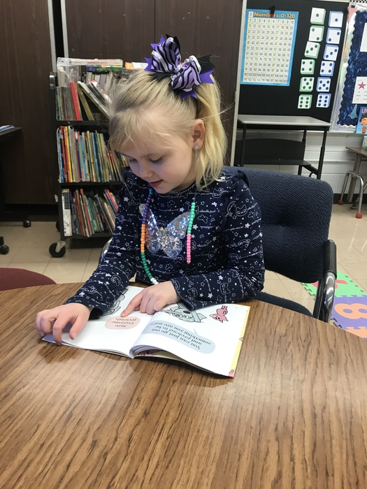 So excited to be able to read on her own.