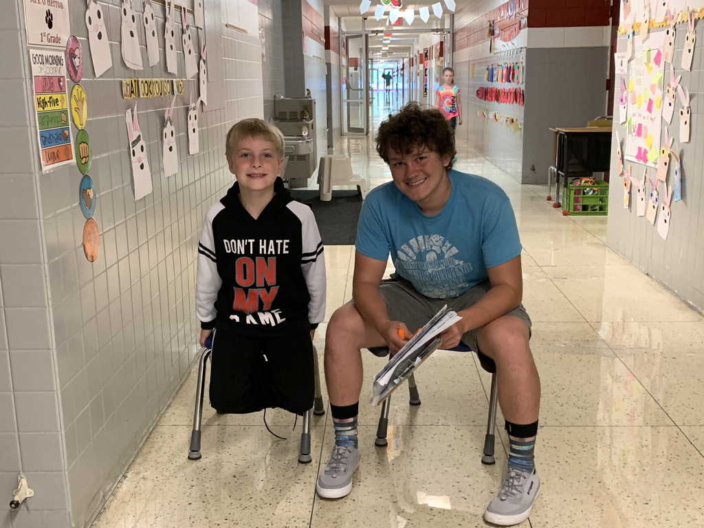 High school helper working with first grade student!