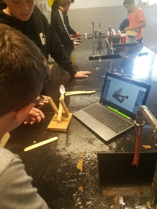 Students in STEM use a 3D modeling program to design and build a catapult. Next week students will participate to see who has the best catapult design.