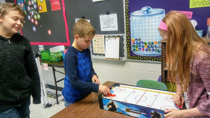 Exploring equivalent fractions with air hockey and a multiplication chart!